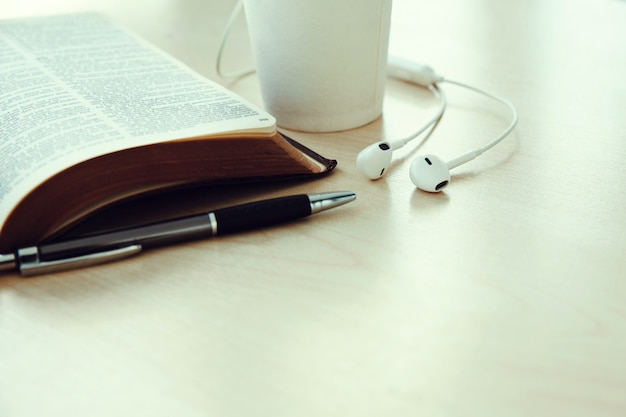 Open book with cup of coffee