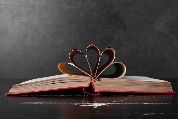 An open book with wrapped pages.