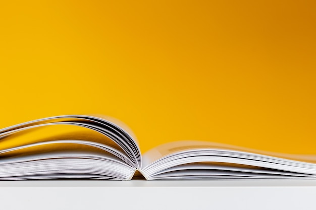 Open book on a yellow background