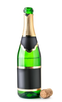 Open bottle of champagne is half empty with a cork on a white background. isolated