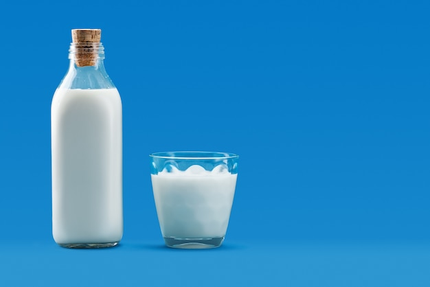 Open bottle and a glass of milk