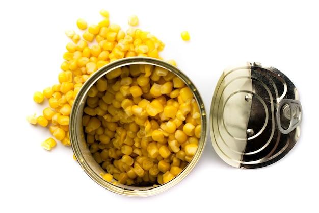 白、分離されたトウモロコシと缶詰食品を開きます。上面図。