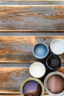 Open cans of different paints, varnish and stain