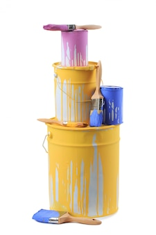 Open cans of paint in different colors and brushes