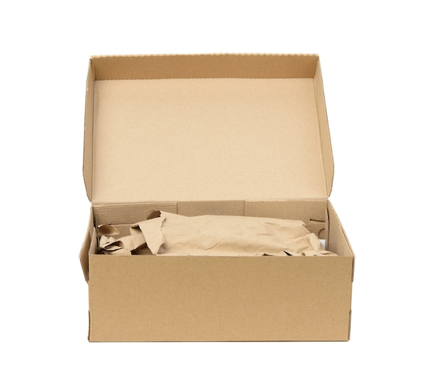 Open cardboard rectangular box made of corrugated brown paper isolated on a white background, close up