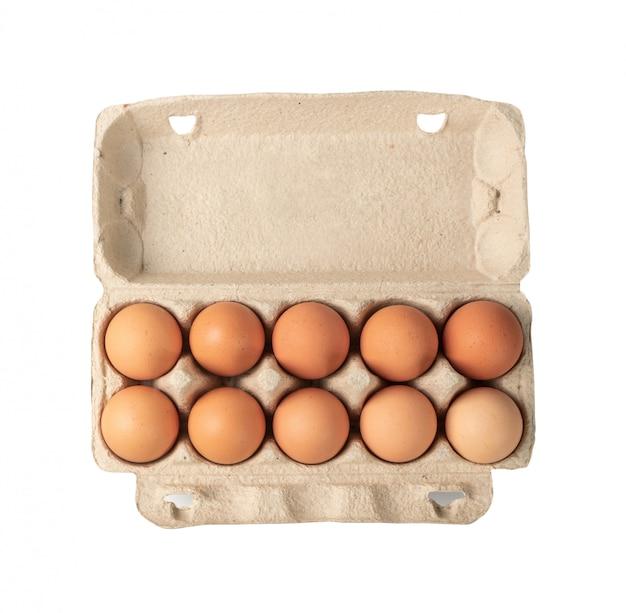 分離された10の茶色の卵とカートンボックスを開く