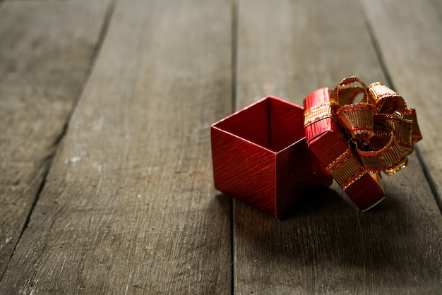 Open christmas presents on wood table with copy space