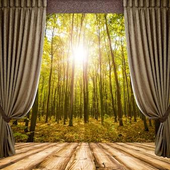 Открытые шторы на фоне осеннего леса