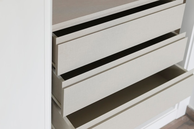 Open drawers of a new built-in closet