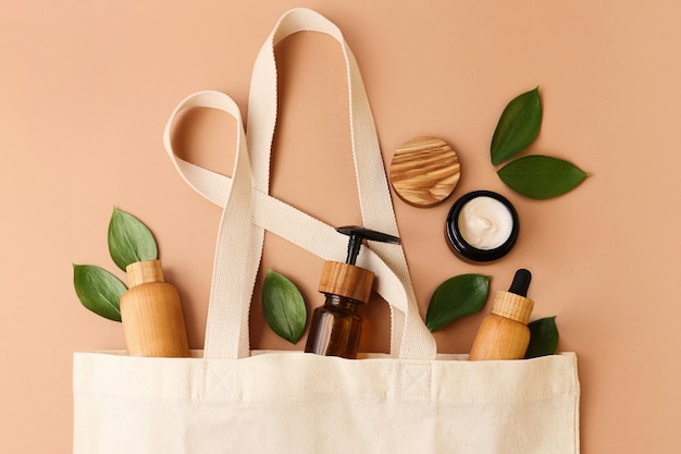 Open eco friendly cotton reusable bag with the different containers from the wood and glass