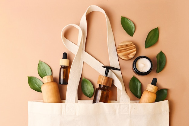 Open ecofriendly cotton reusable bag with the different containersconcept of zero waste cosmetics