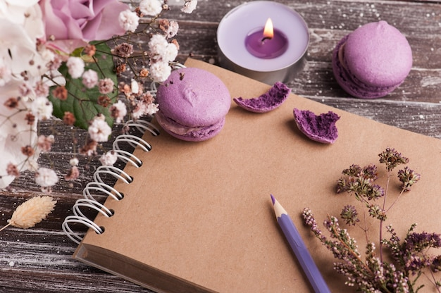 Open empty craft notebook with bouquet of flowers
