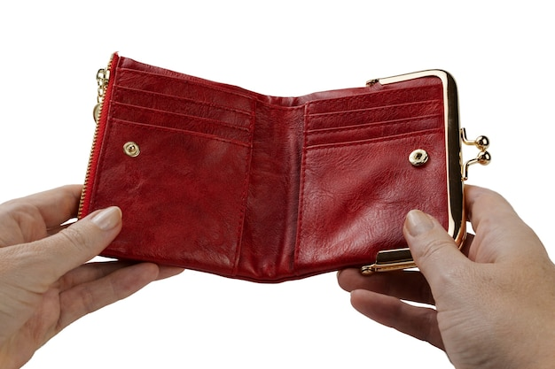 Open empty red purse in a woman's hand, isolated