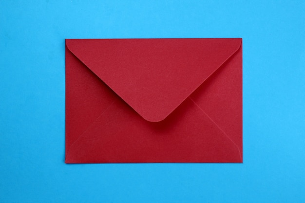 Open envelope in red on a blue background.