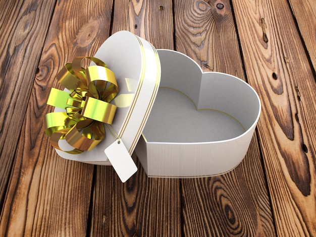 Open gift box in the form of heart on wooden table