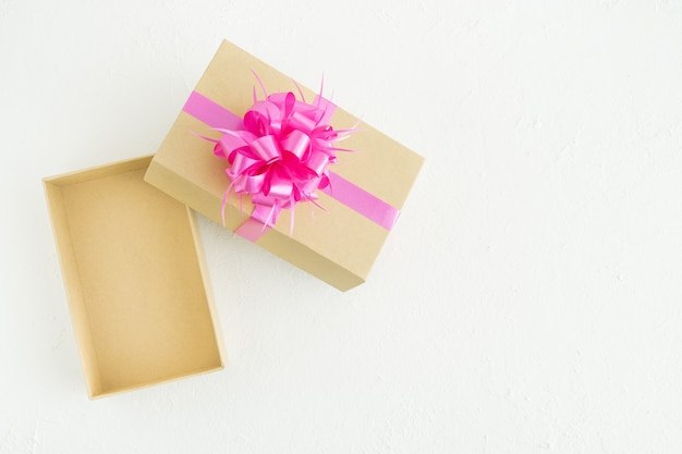 Open gift box with decorations on a white background. copy space. concept valentine's day, mother's day, anniversary.