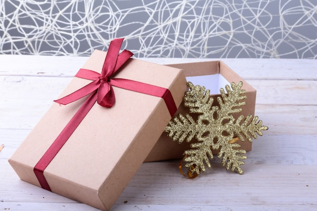 Open gift boxes with bow on wood . christmas decoration