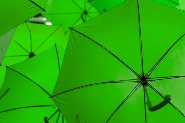 Open green umbrellas used as decoration