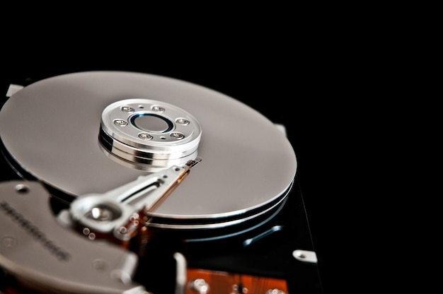 Open hard disk on a black background