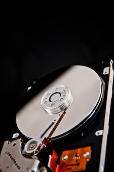 Open hard disk on a black