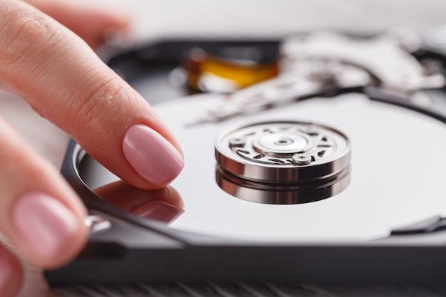 Open hard disk in female hands