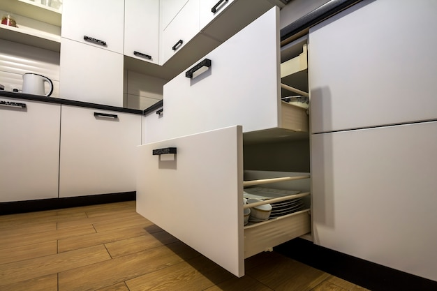 Open kitchen drawer with plates inside