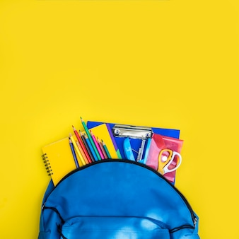 Open knapsack with set of stationery