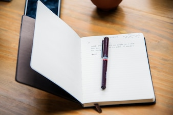 Open leather notebook on a table