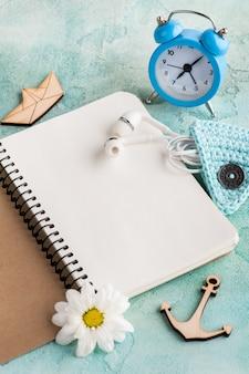 Open notebook, earphones, alarm clock