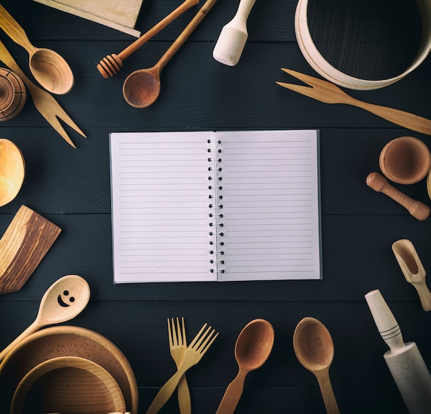 Open notebook in a line on a black table