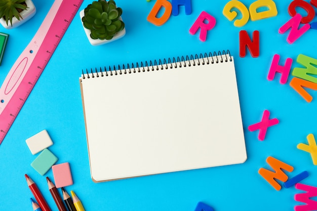 Open notebook in the middle with blank white sheets