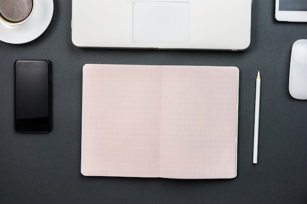 Open notebook and mobile