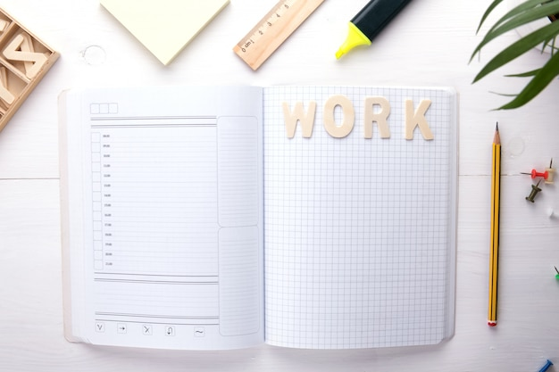 Open notebook and office supplies
