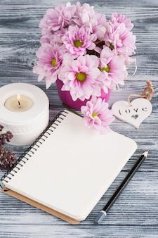 Open notebook, pink daisy flowers