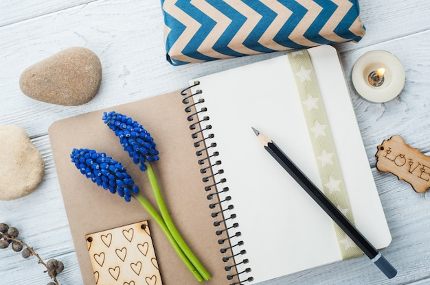 Open notebook with cure floral decoration