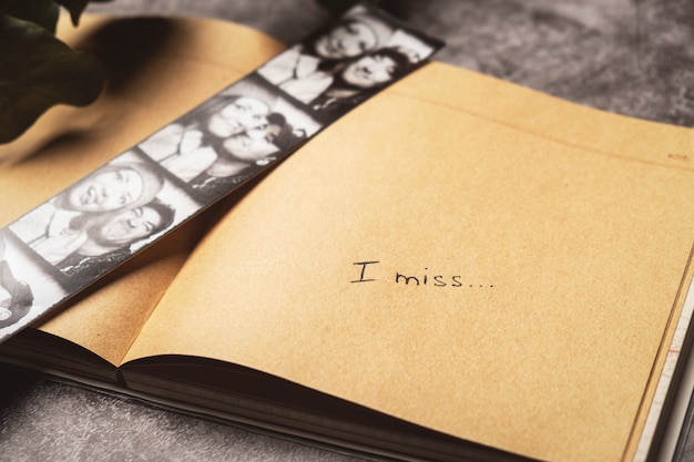 Open notebook with photos of happy couple
