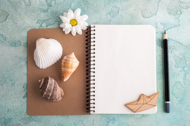 Open notebook with sea elements