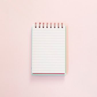 Open notepad for text over pink background