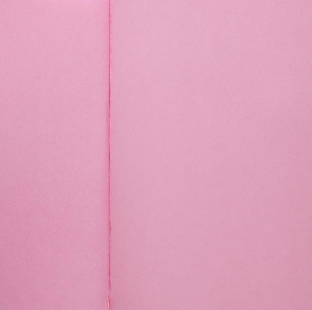 Open notepad texture with pink pages