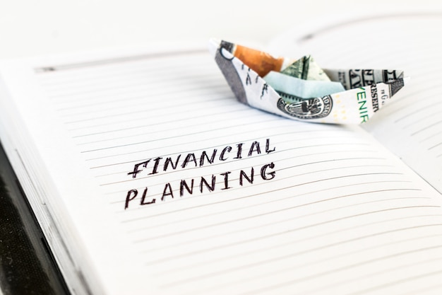 Open notepad with the handwriting text financial planning