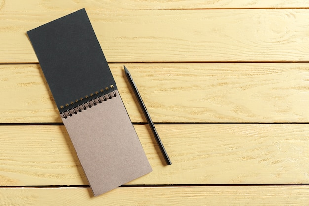Open notepad on wood with copyspace