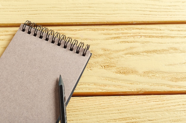 Open notepad on wood
