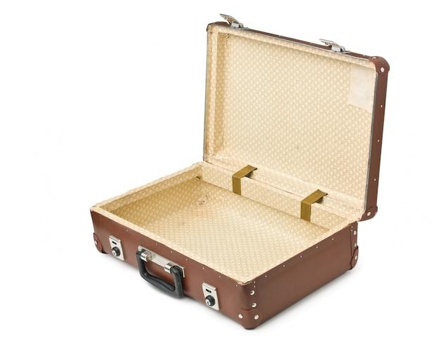 白い背景で隔離の古いスーツケースを開く