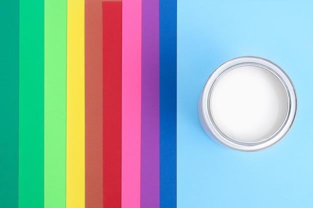 Open paint enamel cans on color palette samples. the concept of repair, construction.