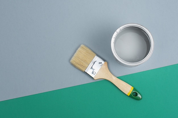 Open paint enamel cans on gray green palette samples. the concept of repair, construction.
