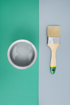 Open paint enamel cans on gray green palette samples
