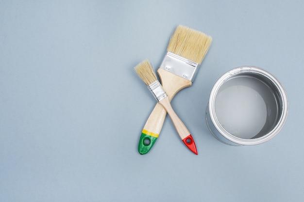 Open paint enamel cans on gray palette samples. concept of repair, construction.