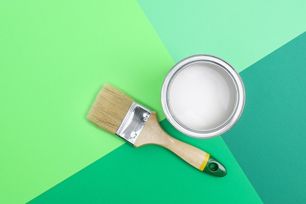 Open paint enamel cans on green palette samples