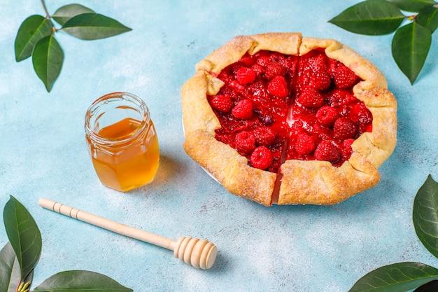 Open pie, raspberry galette. summer berry dessert.