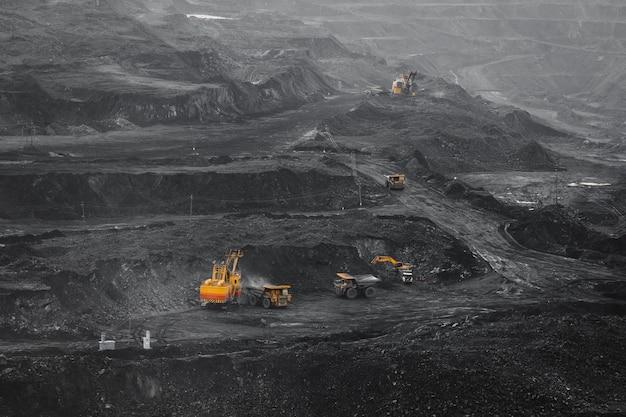 Open pit mine, coal loading in trucks, transportation and logistics